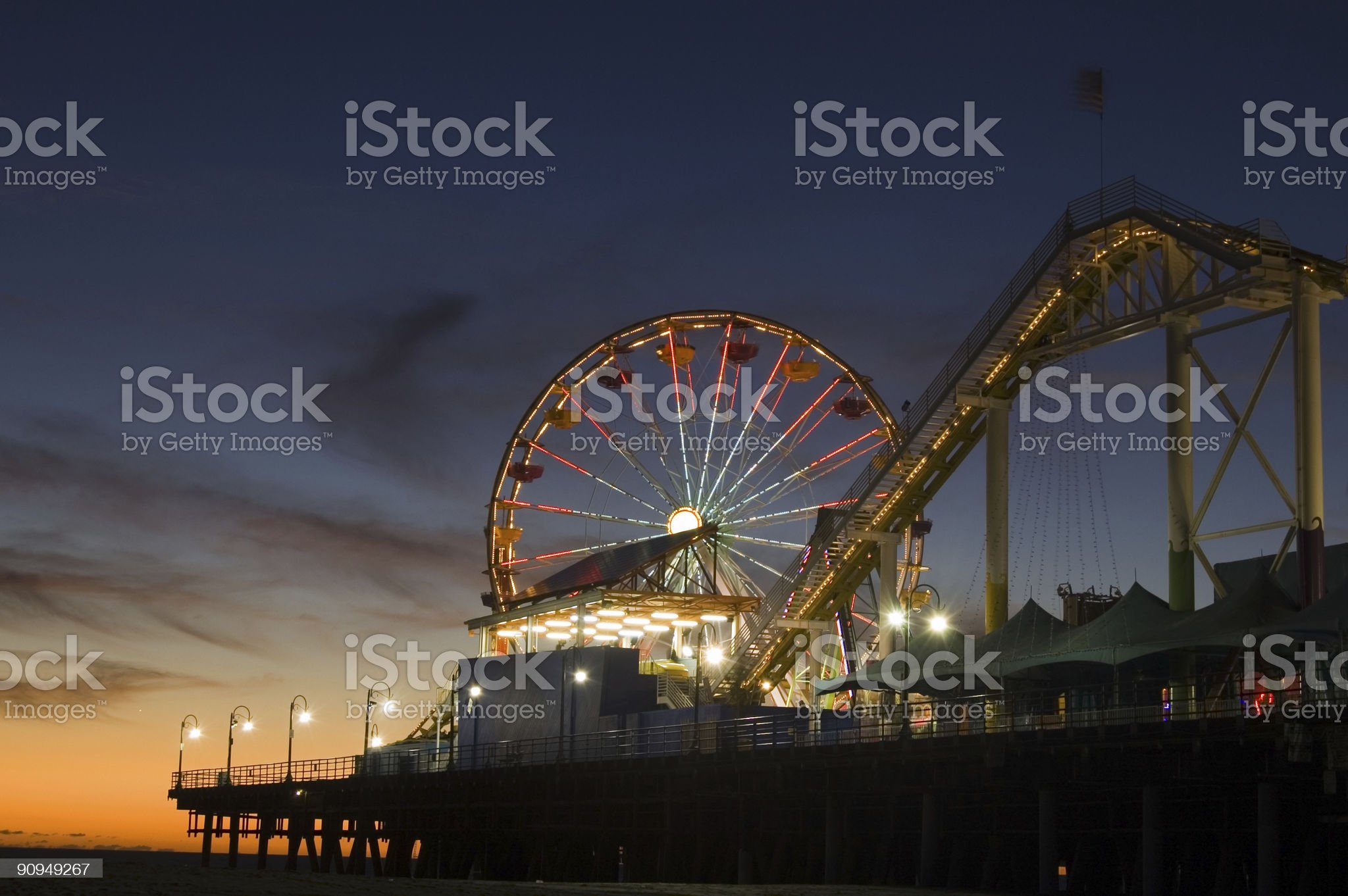 Sunset view of a pier carnival in Santa Monica royalty-free stock photo