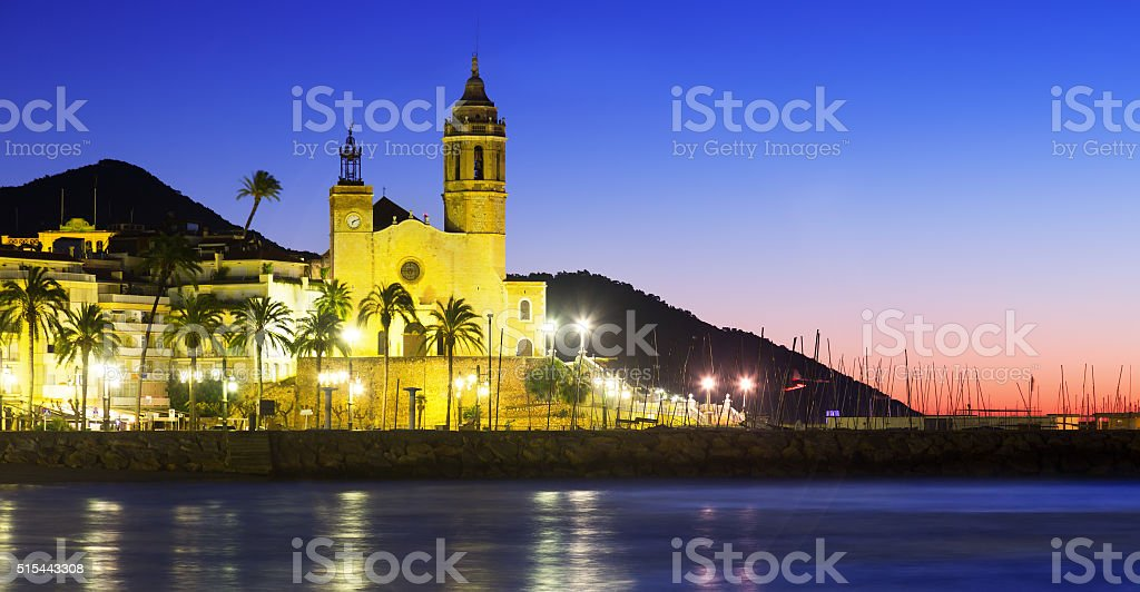 Sunset view of  church at sea beach. Sitges stock photo