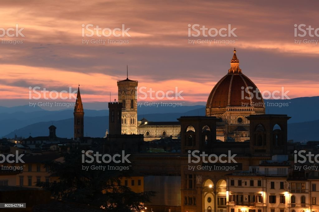 Sunset view of Illuminated Cathedral of Santa Maria del Fiore (Duomo) in Florence, Italy. stock photo
