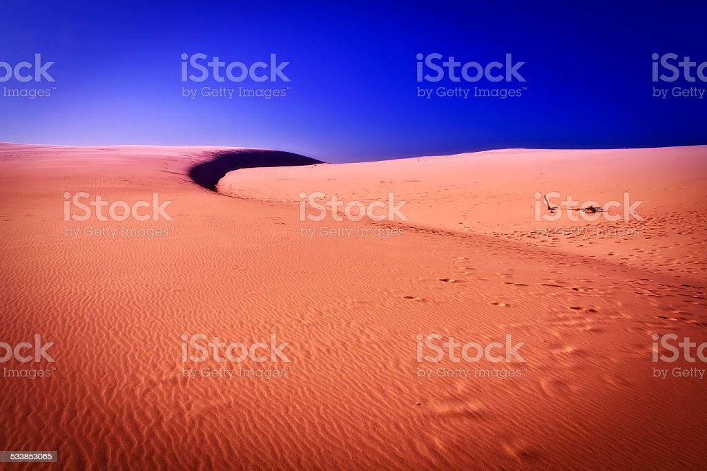Sunset view of sand ripples in the Desert stock photo