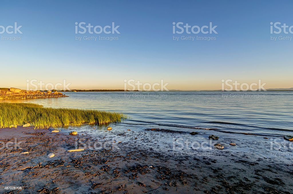 sunset view of seaside beach stock photo
