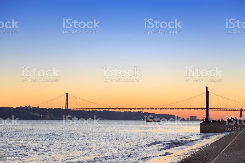 Sunset view of The 25 de Abril Bridge in Lisbon stock photo