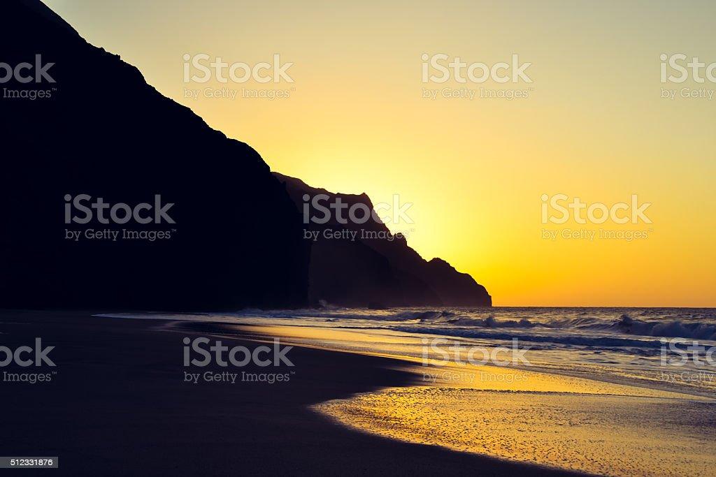 sunset view of the Na Pali Coast at Kalalau Beach stock photo