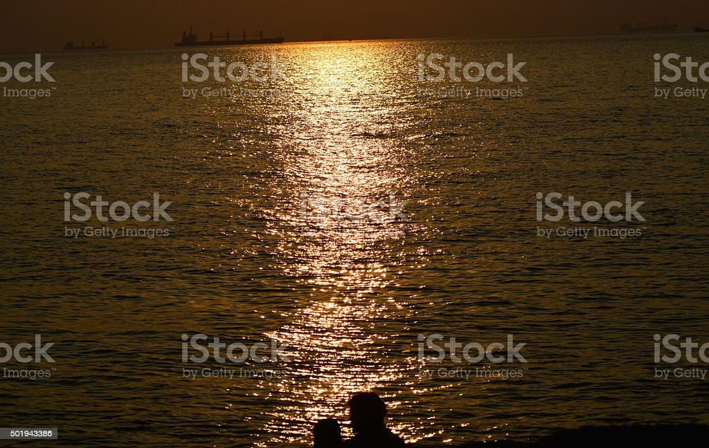 Sunset view with couples figure - stock image stock photo