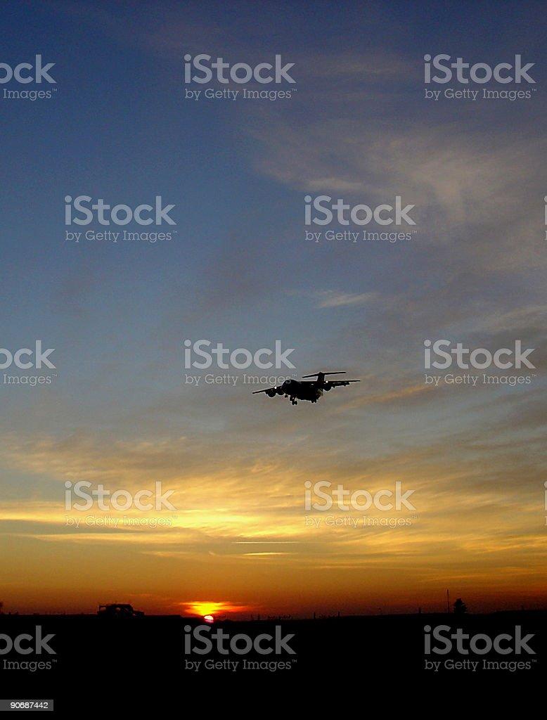 Sunset vs. Airplane royalty-free stock photo