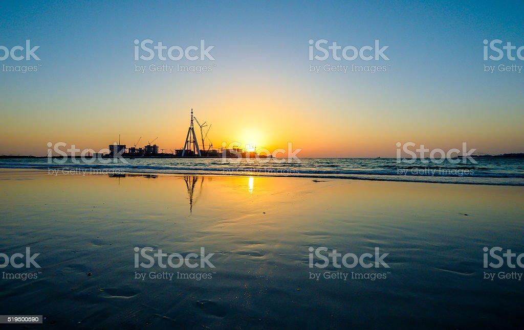 Sunset vs. Dubai Eye Constructions stock photo