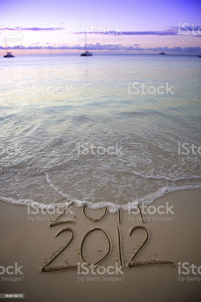 Sunset Wave Wipes 2011 Leaving 2012 in Sand royalty-free stock photo