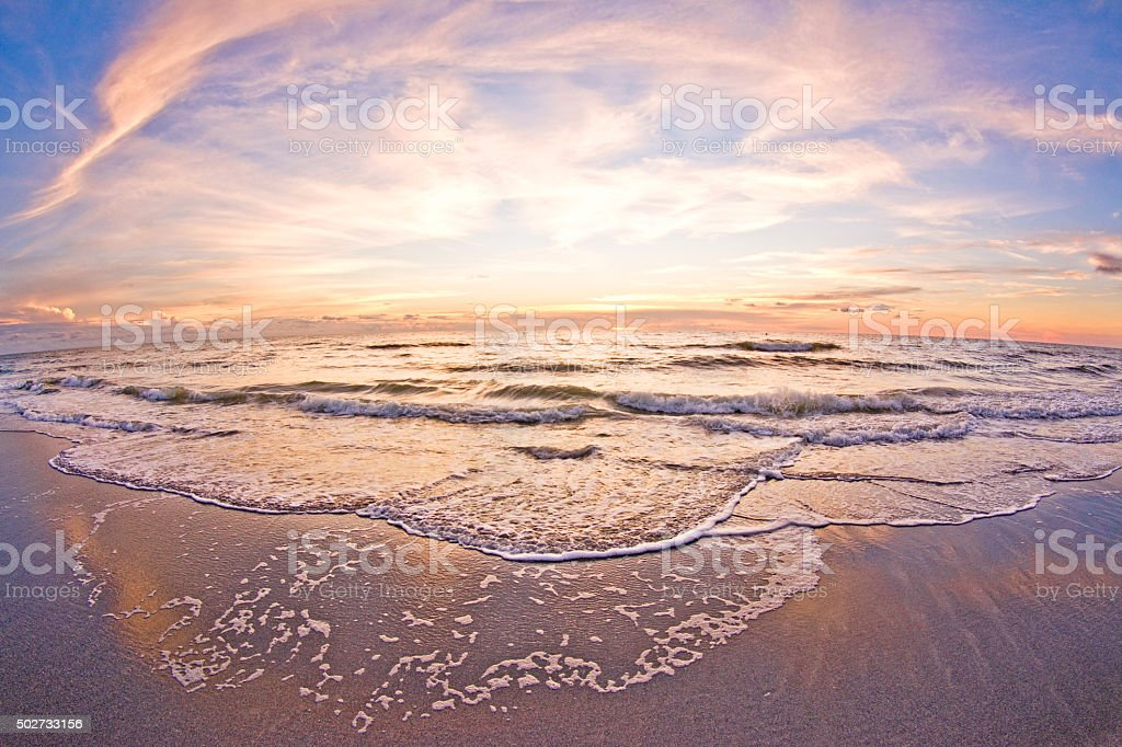 Sunset waves at the shoreline, Tampa, Florida. stock photo