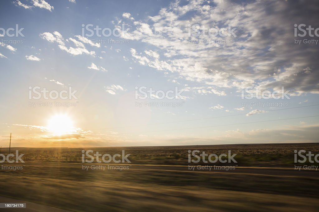 Sunset while driving royalty-free stock photo