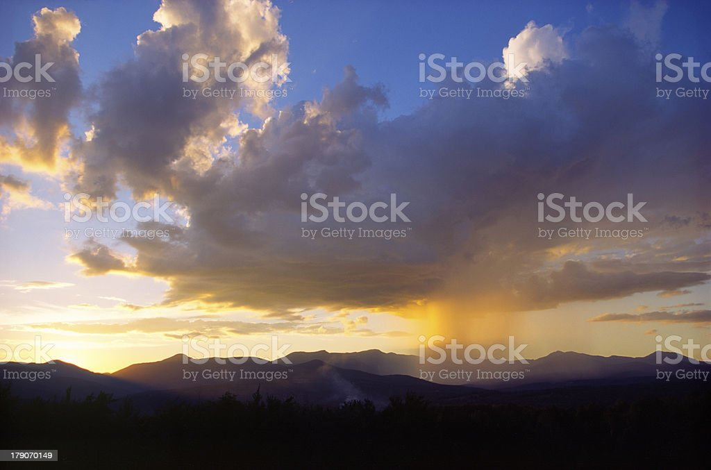 Sunset while raining over Mt. Mansfield, Stowe, Vermont stock photo