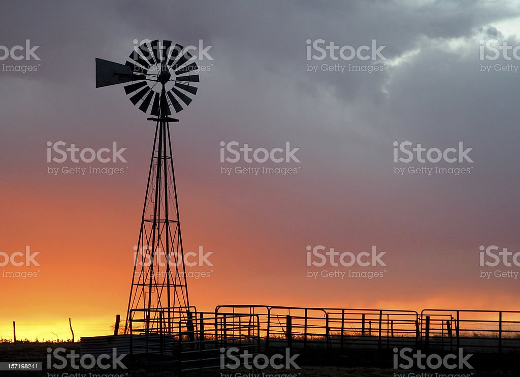 sunset windmill stock photo