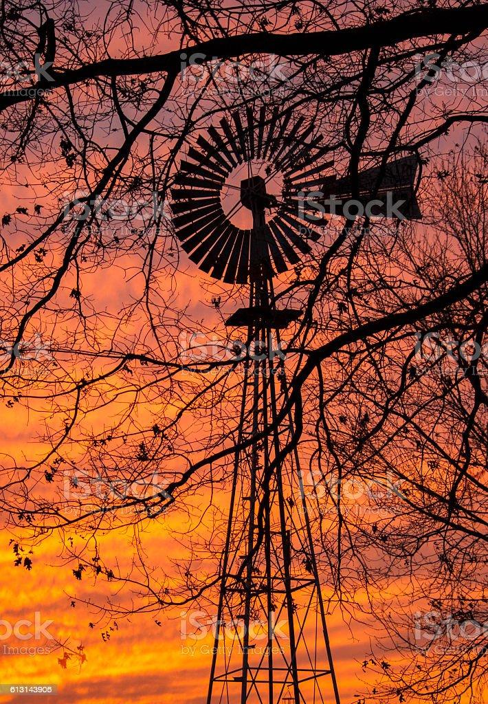 sunset windmill silhoutte stock photo
