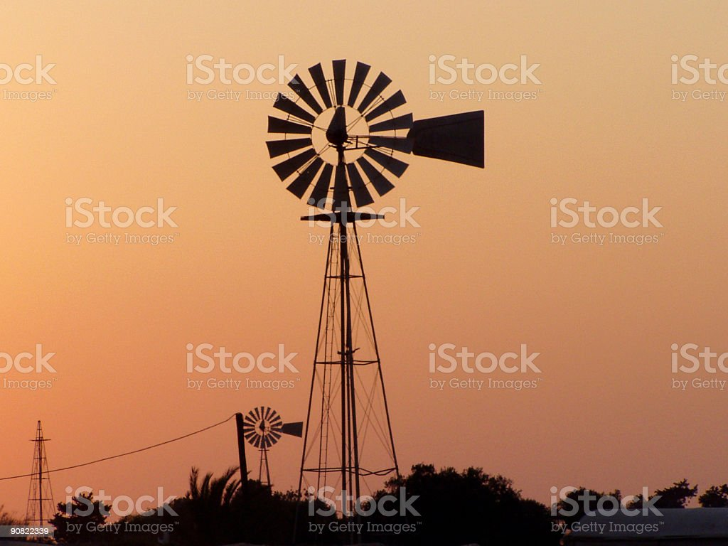 Sunset windmills stock photo