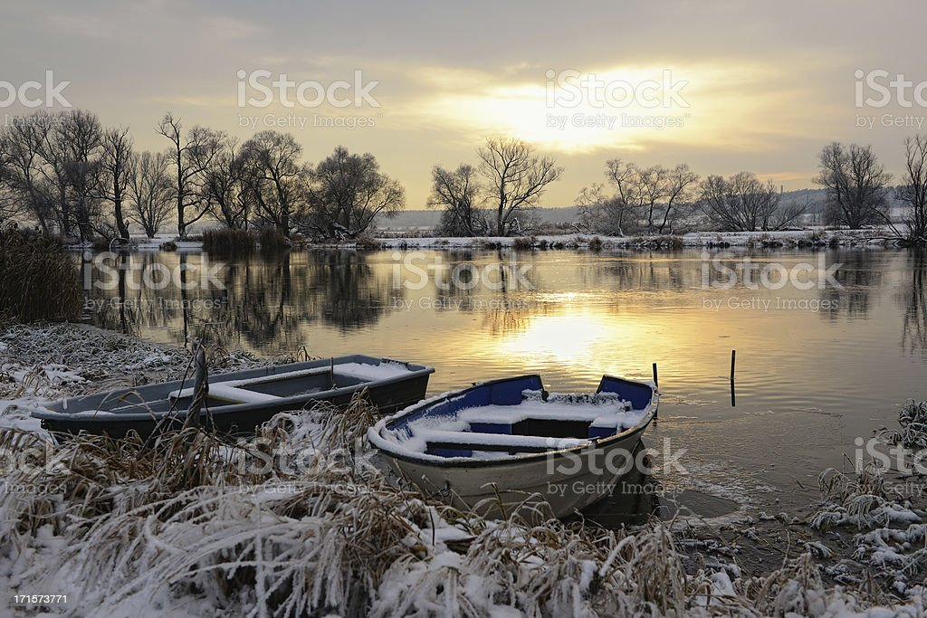 Sunset winter landscape at River with boats stock photo