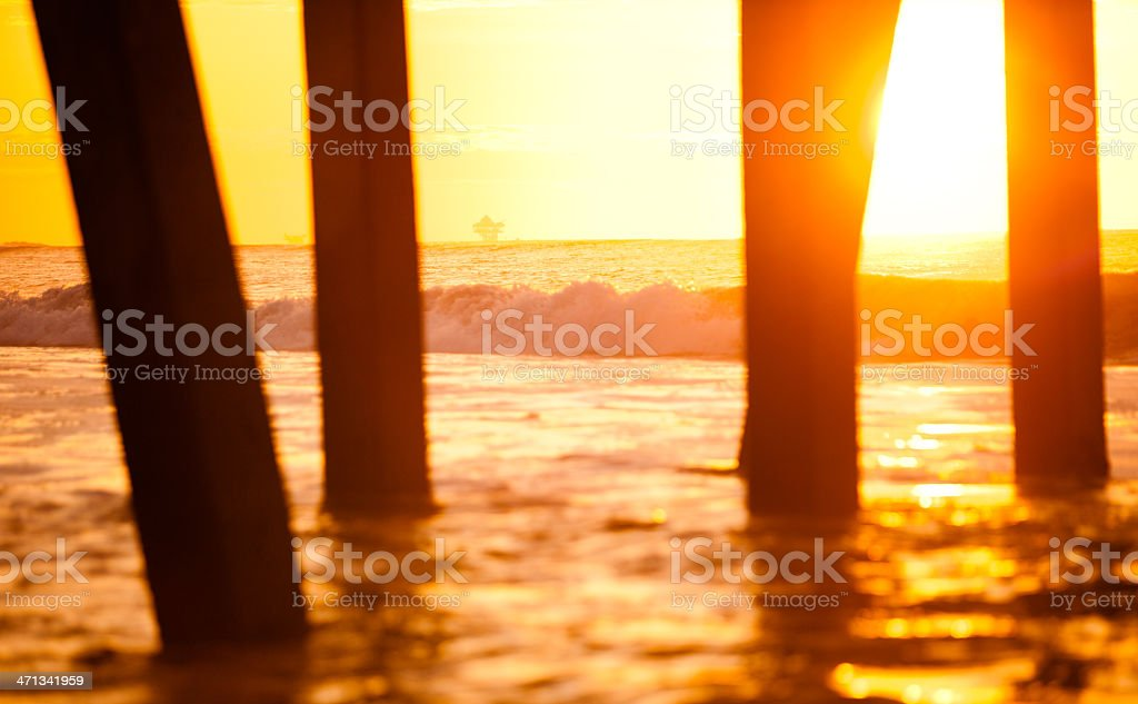 Sunset with an oil rig in the distance stock photo
