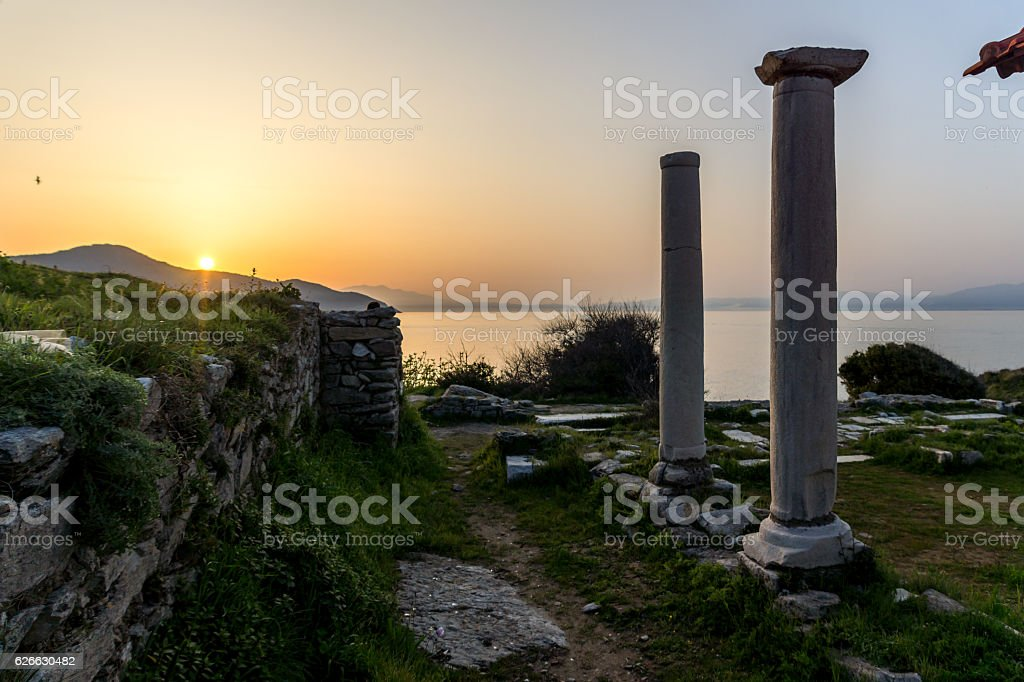 Sunset with ancient columns on Evraiokastro Archaeological Site, Thassos town stock photo