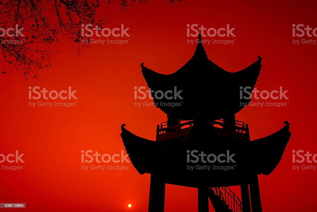 Sunset with Chinese pavilion stock photo