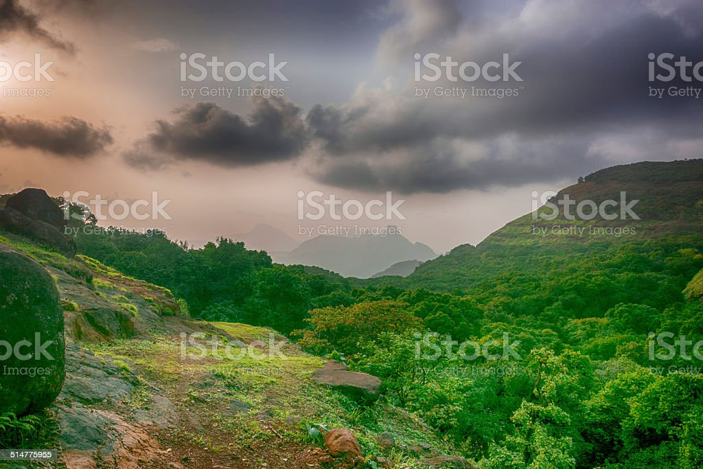 Sunset with clouds over mountains stock photo