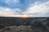 Sunset with cloudy sky in the desert foothills