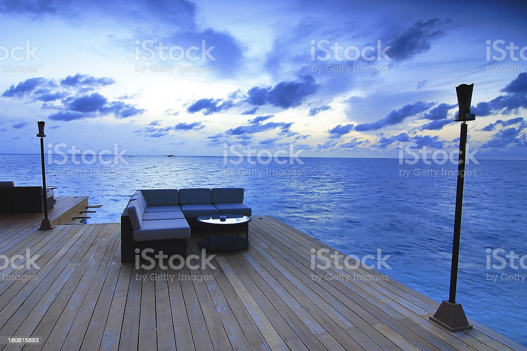 Sunset with comfortable sofa on beach royalty-free stock photo