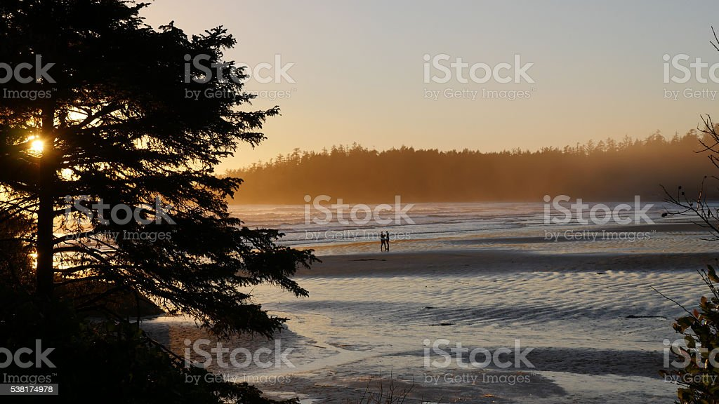 Sunset With Couple Pacific Rim Provincial Park stock photo