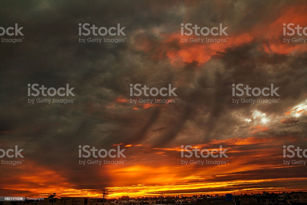 Sunset with dark clouds. Soft Focus. Grains. stock photo