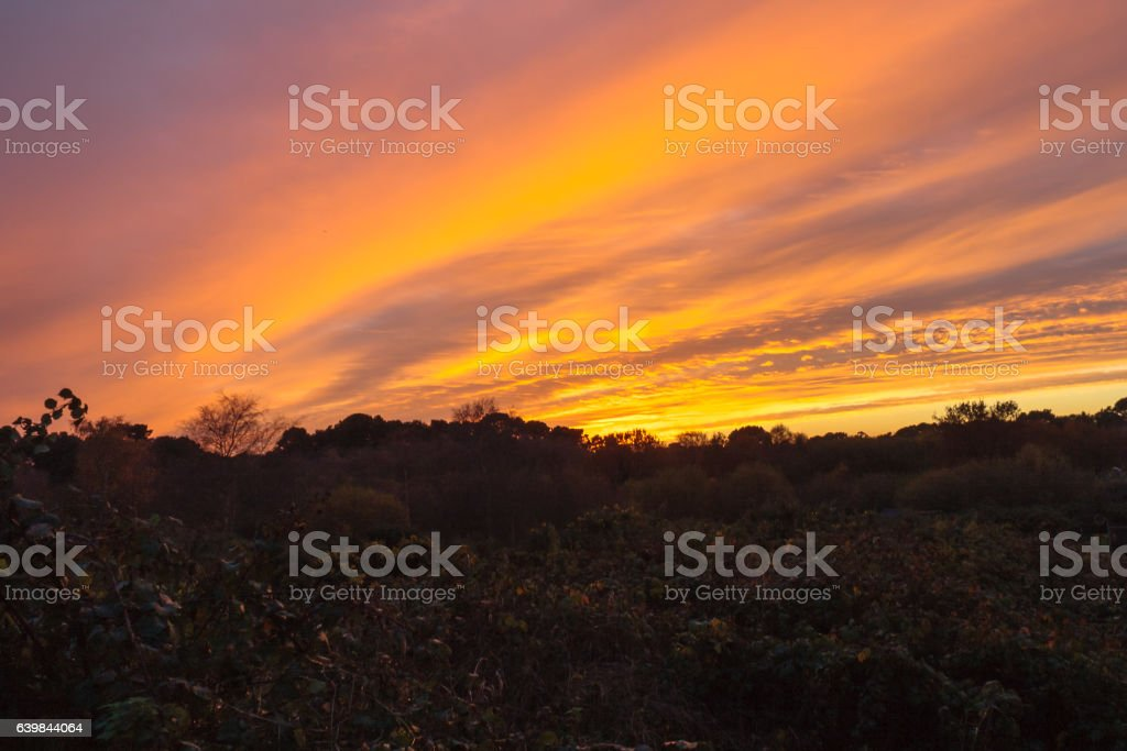 Sunset with diagonal cloud formation stock photo