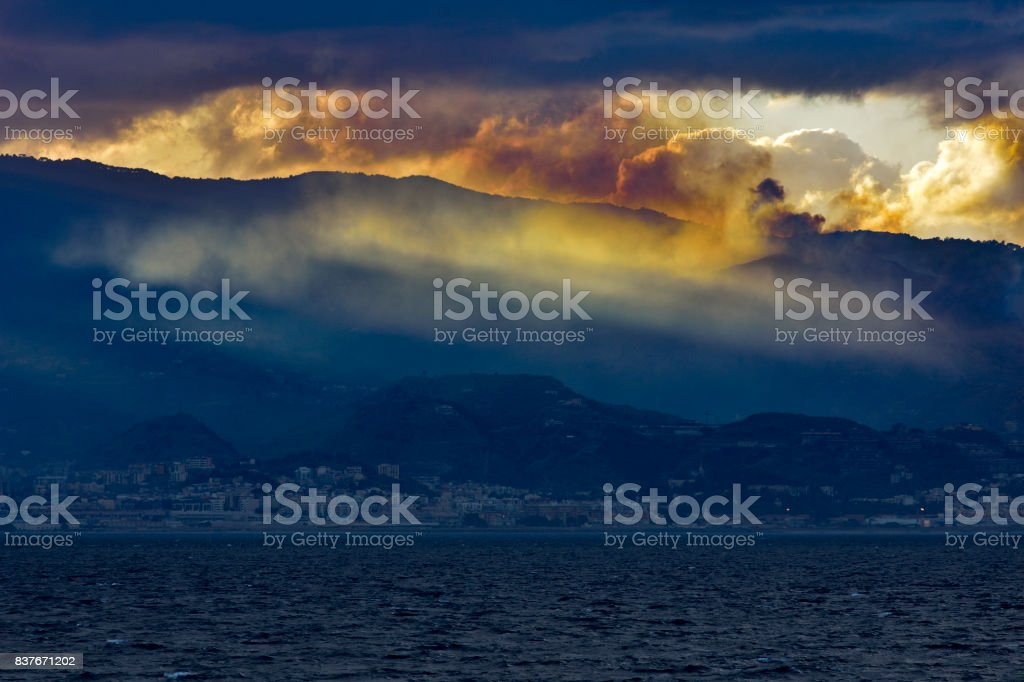 Sunset with fire and sea. stock photo