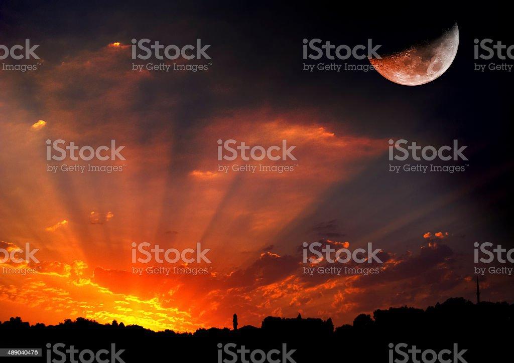 Sunset with Halfmoon stock photo
