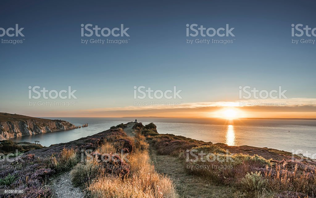 Sunset with Heather in flower in the foreground stock photo
