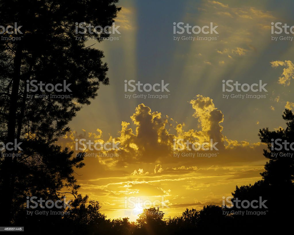 Sunset with High clouds and Sunbeams stock photo