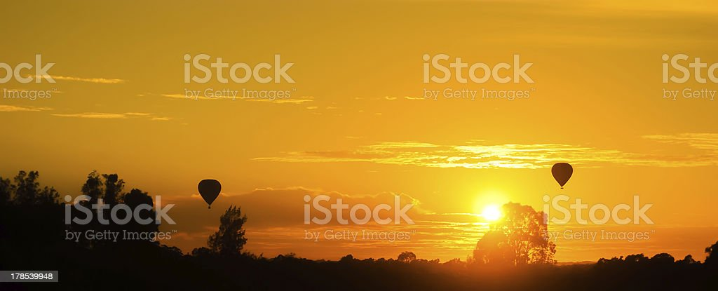 Sunset with hot-air balloons royalty-free stock photo