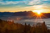 sunset with lens flares at the swiss mountains