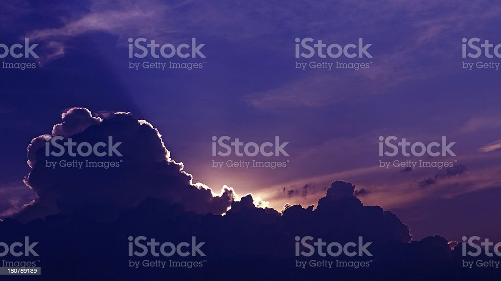 Sunset with lighting shade behind the cloud stock photo