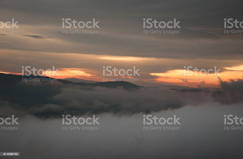 sunset with mist, fog stock photo