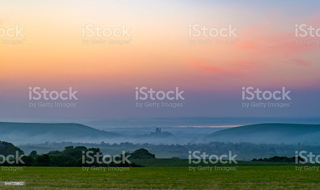 Sunset with mist rolling in stock photo