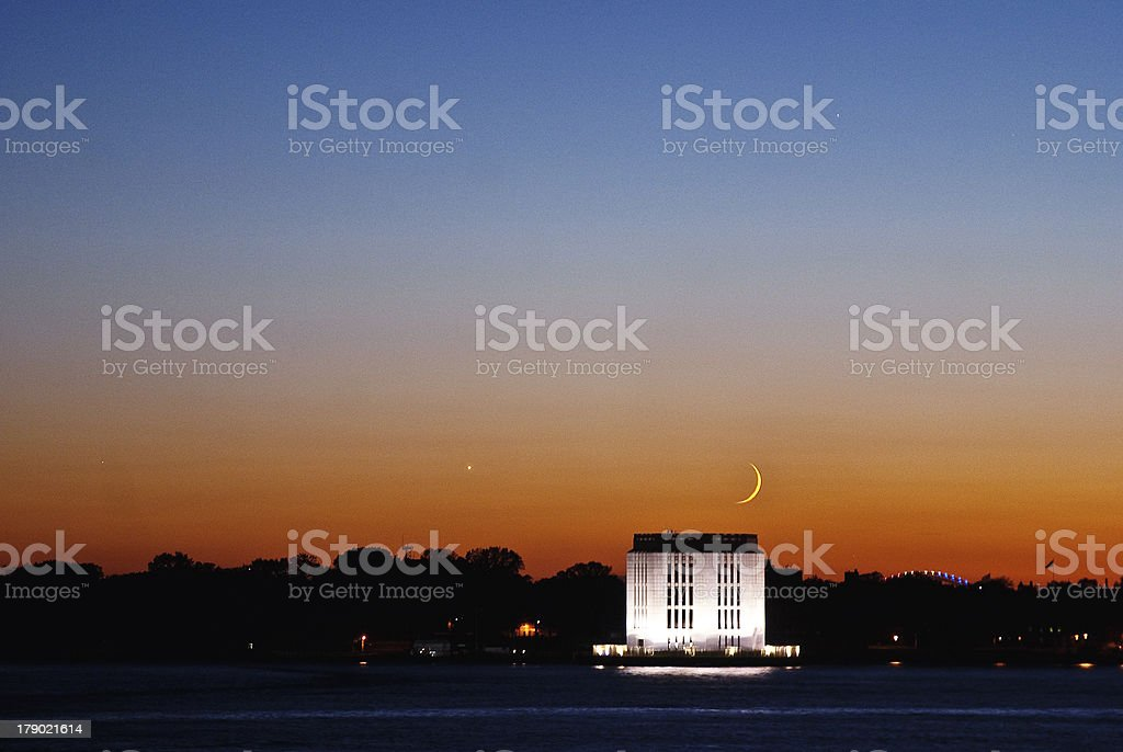 Sunset with Moon over Governors Island stock photo