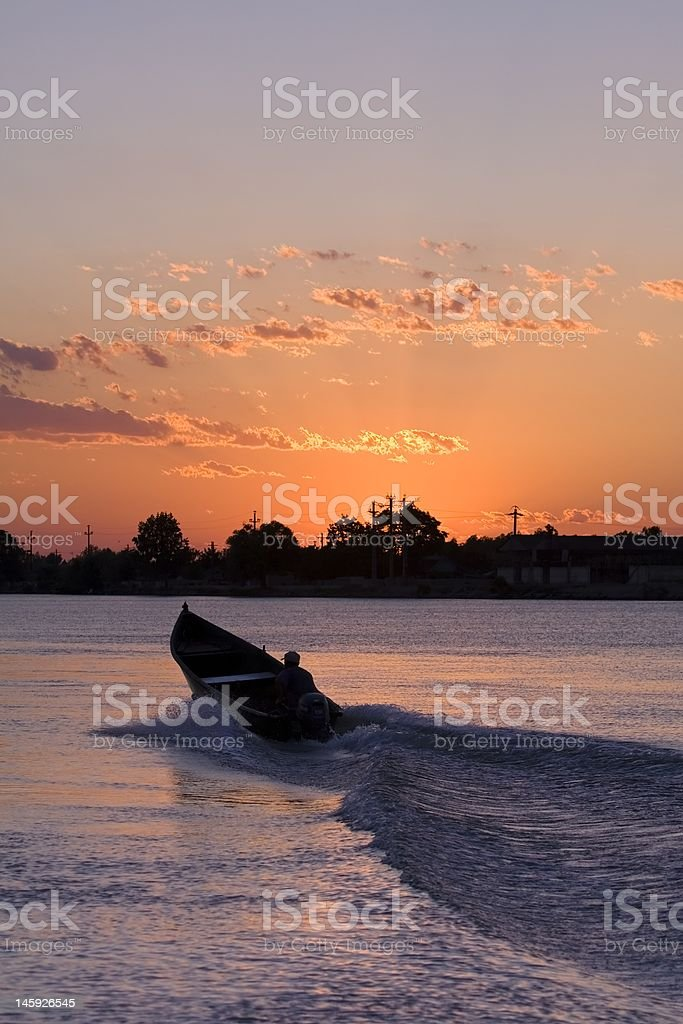 Sunset with motor boat stock photo