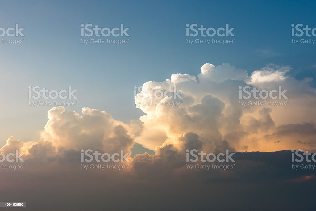 sunset with multi-color clouds stock photo