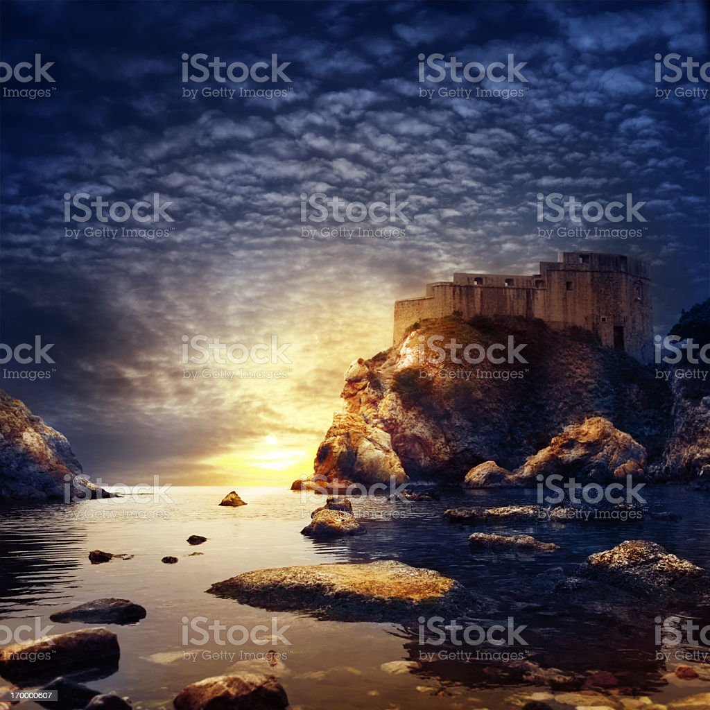 Sunset with old fortress. Dubrovnic, Croatia, Europe. stock photo