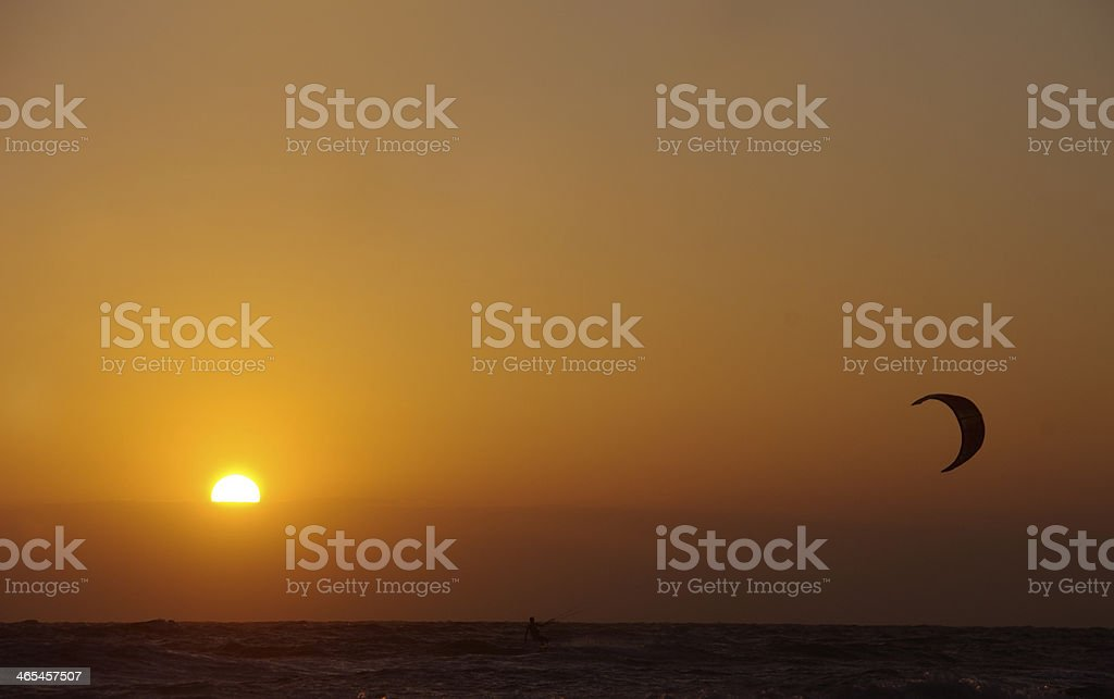 Sunset with parachute surfer royalty-free stock photo