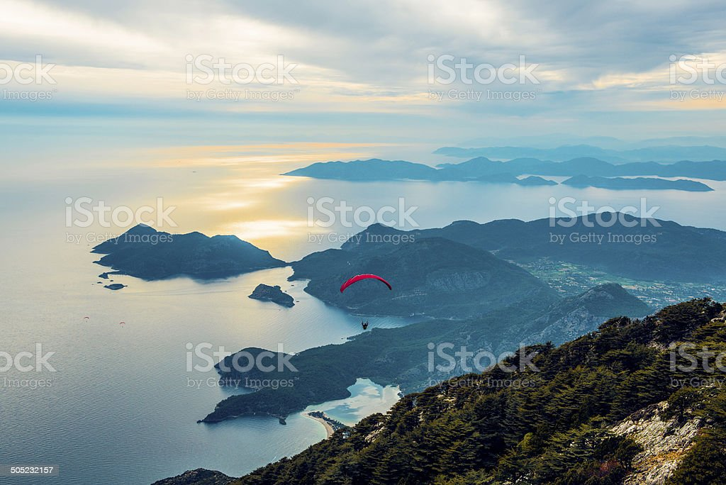 Sunset with paragliding stock photo