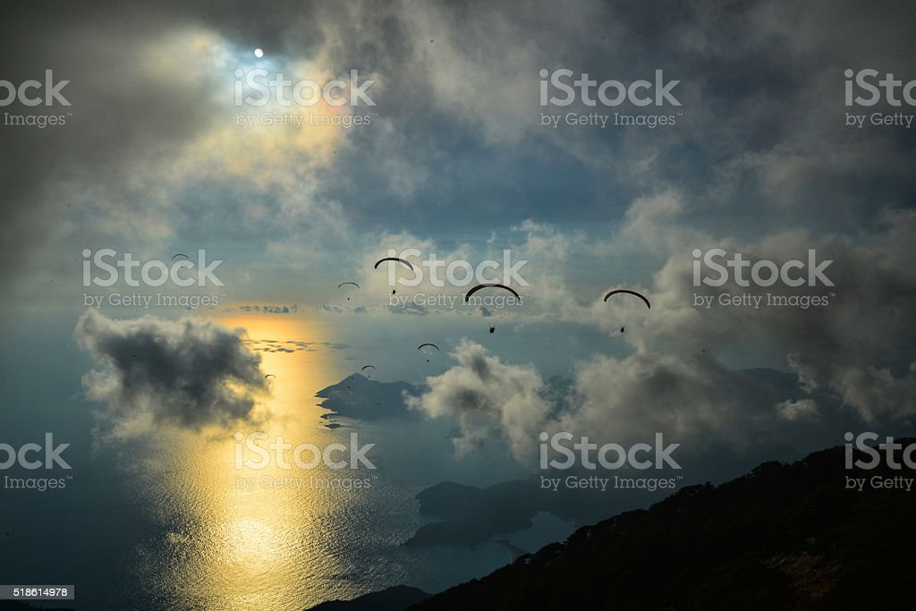 Sunset with paragliding. stock photo