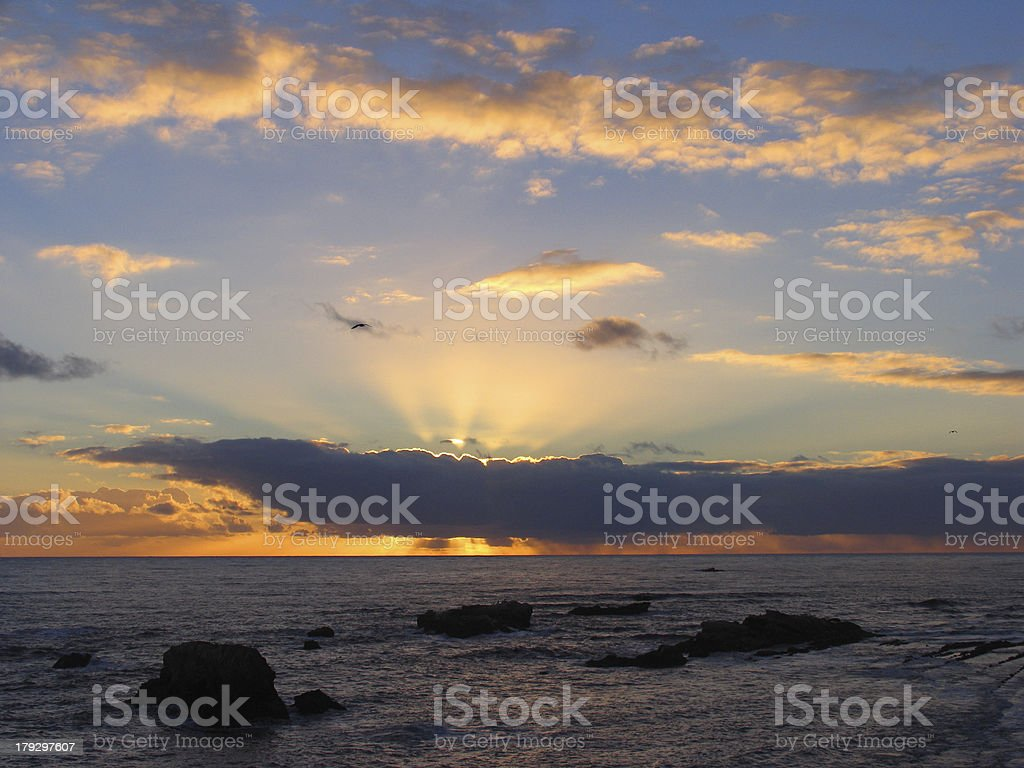 Sunset with Rippling Ocean on the Beach royalty-free stock photo