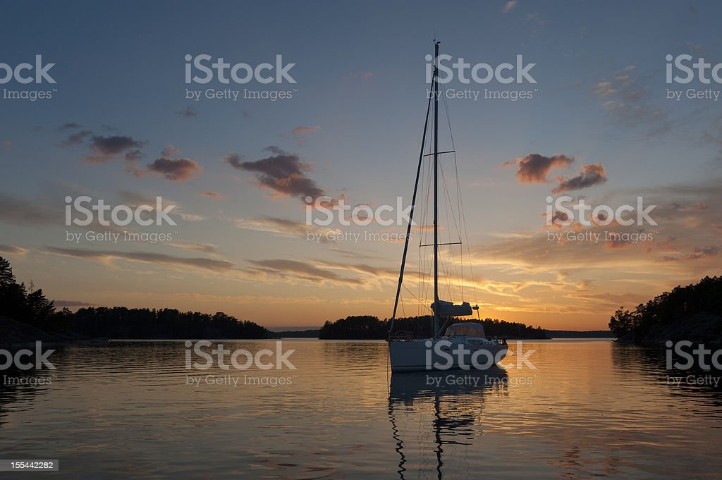 Sunset with sailboat at anchor in the archipelago stock photo