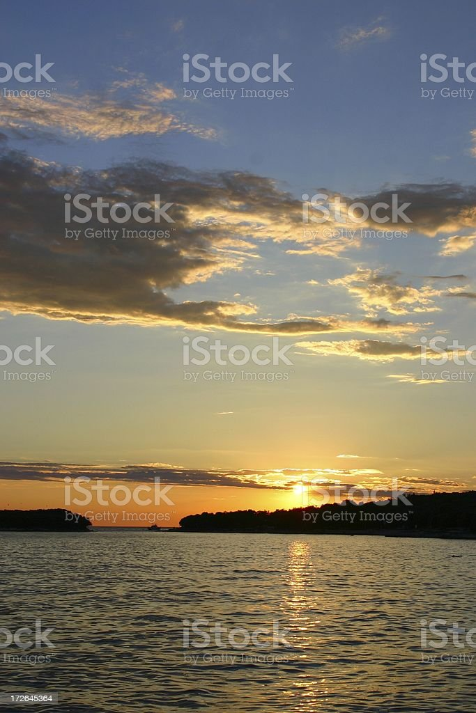 Sunset with sailing boat royalty-free stock photo