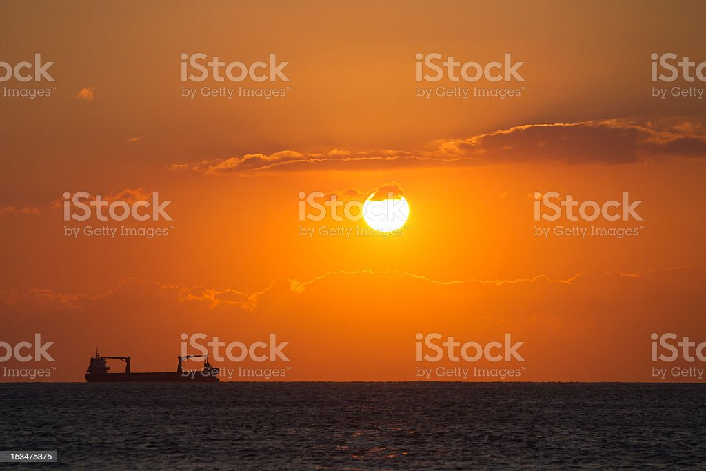 Sunset with ship stock photo
