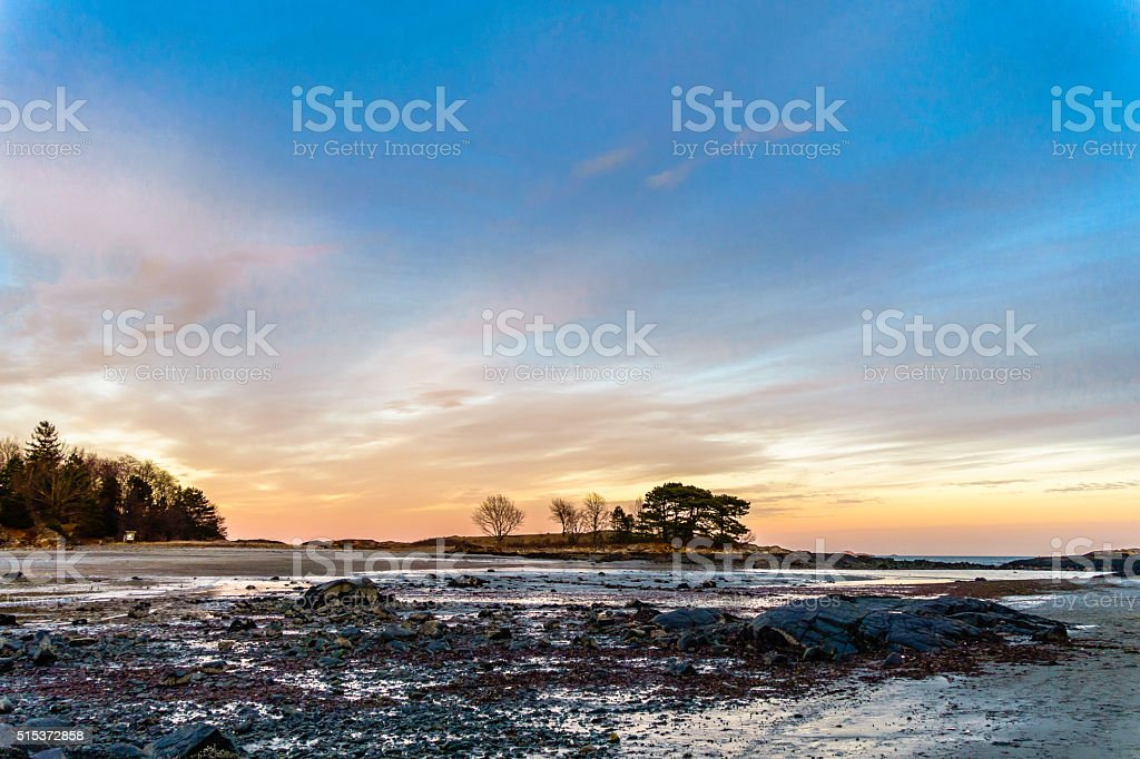 sunset with silhouette of trees stock photo