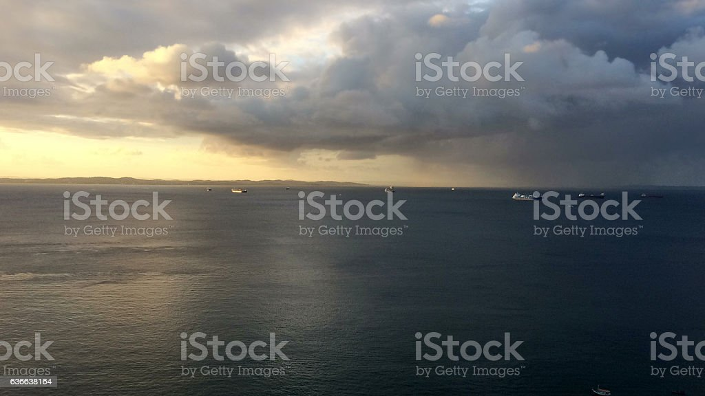 Sunset with storm at Bay of All Saints in Brazil stock photo