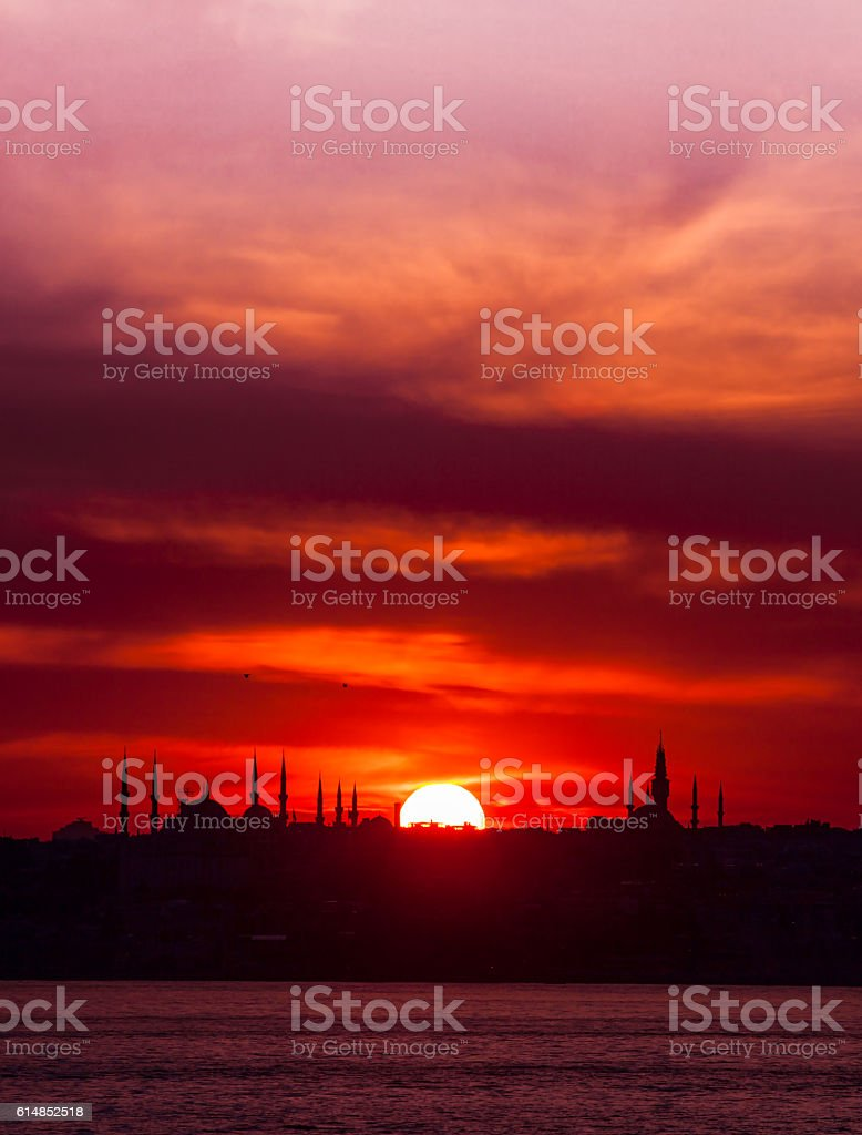 Sunset with sun behind silhouette in Istanbul,Turkey stock photo